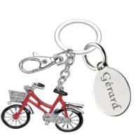 Gravure d'un texte sur un porte clefs bicyclette rouge