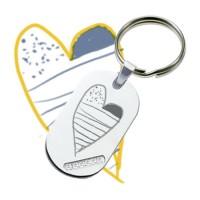 Porte-clés métallique avec brillants gravé d' un dessin.