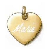 Coeur bombé plaqué or avec un texte