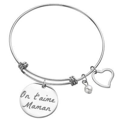 Bijou bracelet jonc avec son médaillon rond argenté gravé avec un texte.