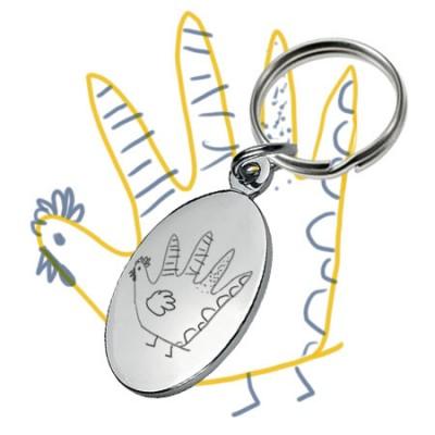 Porte-clés ovale personnalisé avec la gravure d'un dessin de votre enfant.