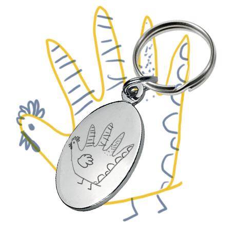 Gravure de dessin d'enfant sur porte-clés métallique ovale